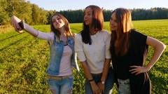 Friends,  girls, caucasians, have fun outdoors, make selfie, slow motion. - stock footage