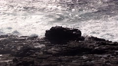 Sea surf on the rocks in the area  Punta Pesebre  on Fuerteventura Stock Footage