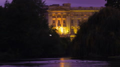 Panning shot of Buckingham Palace time-lapse from Saint James Park in London Stock Footage
