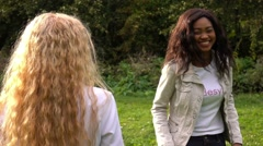 Friends,  girls, caucasian and african, having fun in park, slow motion. - stock footage