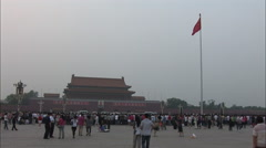 Tiananmen Gate, Chinese flag, crowds Stock Footage