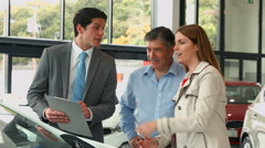 Happy couple discussing car details Stock Footage