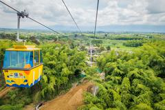 NATIONAL COFFEE PARK, COLOMBIA, Downward view of yellow cable car descending by Stock Photos