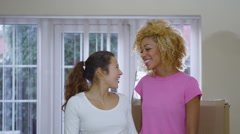 4K Happy affectionate gay female couple holding up the key to their new home Stock Footage