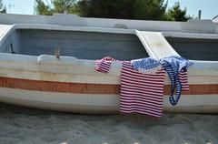 Navy look summer shirts on old boat Stock Photos