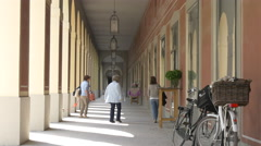 Women walking along the columns of the German Theater Museum, Munich Stock Footage