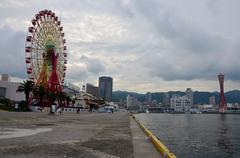 Ferris wheel and tower at Kobe Harborland - stock photo