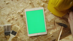 Preparing  carpentry tools with tablet pc in portrait mode in the middle Stock Footage