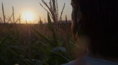 Profile view of handsome man with beard with nature landscape in sunset/sunrise. Stock Footage