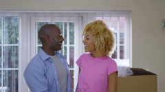 4K Happy affectionate couple holding up the key to their new home - stock footage