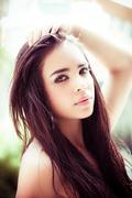 Beautiful headshot of latina model looking into camera with seductive dark eyes Stock Photos