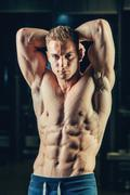 Silhouette of a athlete. Confident young fitness man with strong hands. Dramatic Stock Photos