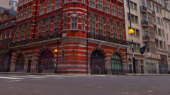 Panning shot of Wide angle time-lapse of an intersection at Saint James Place in Stock Footage