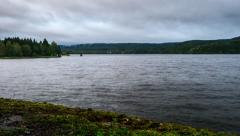 Scandinavian landscape with big lake, early fall, storm clouds, timelapse Stock Footage