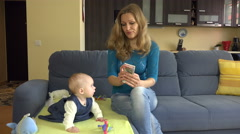 Mom with baby count euro. unemployed women take care baby home. 4K Stock Footage