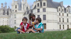 Funny children kids, little boys and their mother, eating ice cream on a lawn Stock Footage