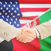 Businessmen handshake - United States and Afghanistan Stock Photos
