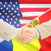 Businessmen handshake - United States and Andorra - stock photo