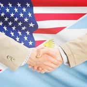 Businessmen handshake - United States and Argentina - stock photo