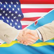 Businessmen handshake - United States and Aruba - stock photo