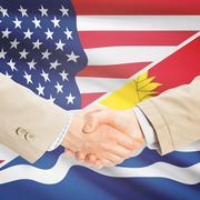 Stock Photo of Businessmen handshake - United States and Kiribati