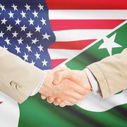 Businessmen handshake - United States and Pakistan Stock Photos