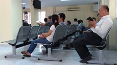 Visitors in immigration office in Saigon city Stock Footage