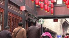 Starbucks, old Chinese street, Chengdu Stock Footage