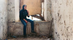 The young man smokes in an abandoned house. The concept of depression, crime Stock Footage