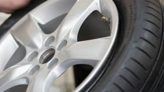 Pumping tire with alloy wheel Stock Footage