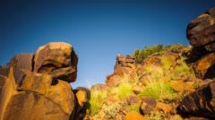 Rocks and a Bushmen engraving at sunset Stock Footage