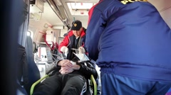 Medics at work in the ambulance Stock Footage