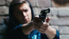 Teenager shoots a gun. Concept: crime, dysfunctional families Stock Footage