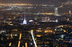 Aerial view of Turin in Italy with the illuminated Mole Antonelliana - stock photo