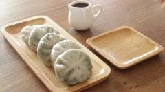 Having steamed dumpling stuff on wooden plate Stock Footage
