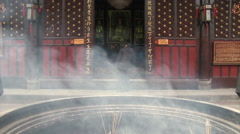 Incense & smoke in Buddhist Temple, China Stock Footage