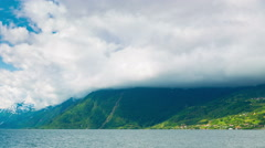 Norway Mountains And Fjord View - Clouds Time Lapse, Pan Left Stock Footage