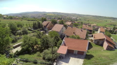 AERIAL: Streets and houses in a small town. Stock Footage