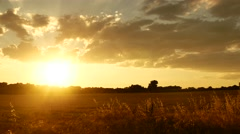 Golden hours sun set south france clouds field large Stock Footage