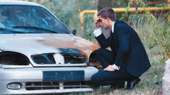 The young driver from the car burned. Calls insurance agent. Concept: accident - stock footage