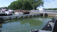 Recreational vessels in lock chamber, waiting for the water level to decrease Stock Footage