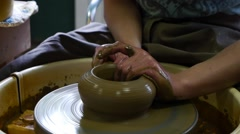 Clay potter artist making pot shape on wheel pedestal - stock footage