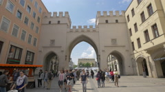 Walking near and under the Karlstor gates in Munich - stock footage