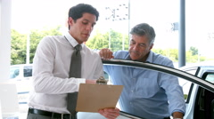 Businessman explaining the car details Stock Footage