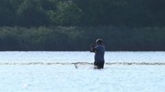 Fisherman throwing his fishing net at lake. Fisherman fishing fish. Stock Footage