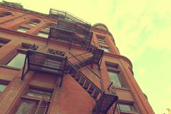 Metal fire escape on facade of old building in Toronto Kuvituskuvat