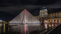 Night hyperlapse of the Louvre Pyramid in Paris Stock Footage