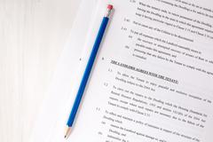 Lease agreement document with pencil - stock photo