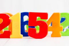 Playing with colored numbers Stock Photos