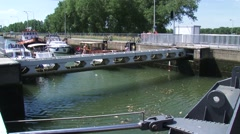 LOCK COMPLEX MAASBRACHT Recreational vessels in lock chamber Stock Footage